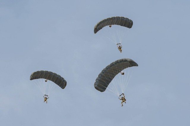 YUMA PROVING GROUNDS, Arizona- Three U.S. Army Special Forces Soldiers with 1st Special Forces Group (Airborne) prepares to land after a High Altitude High Opening jump January 13th, during a three week training exercise at the U.S. Army Yuma Training Ground. This training exercise helped hone the SF Team's HALO and high altitude high opening (HAHO) skills to ensure their excellence in future operations.