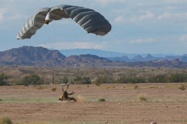 YUMA PROVING GROUNDS, Arizona- A U.S. Army Special Forces Soldier with 1st Special Forces Group (Airborne) slides into his landing after a High Altitude Low Opening jump January 13th, during a three week training exercise at the U.S. Army Yuma Training Ground. This training exercise helped hone the SF Team's HALO and high altitude high opening (HAHO) skills to ensure their excellence in future operations.