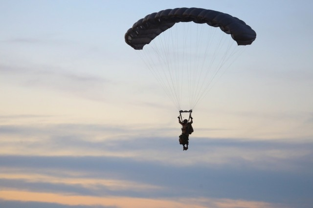 YUMA PROVING GROUNDS, Arizona- A U.S. Army Special Forces Soldier with 1st Special Forces Group (Airborne) prepares to land after a High Altitude Low Opening jump January 16th, during a three week training exercise at the U.S. Army Yuma Training Ground. This training exercise helped hone the SF Team's HALO and high altitude high opening(HAHO) skills to ensure their excellence in future operations.