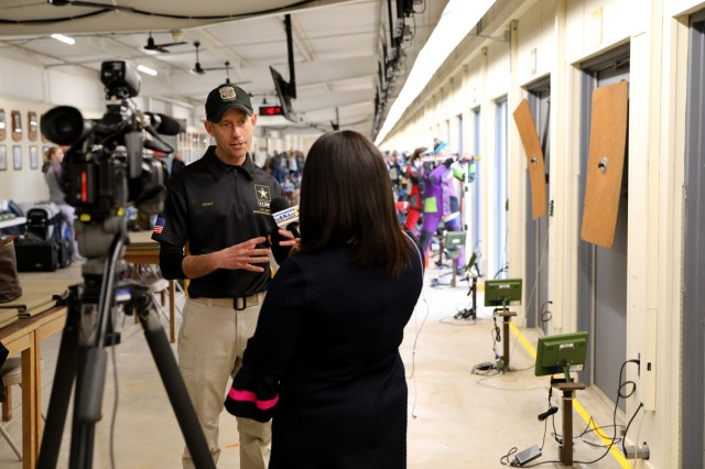 U.S. Army Sgt. 1st Class Hank Gray, a Belgrade, Mont. native who is the International Rifle Team chief, speaks to Mya Johnson from WTVM Newleader 9 about the U.S. Army Junior Rifle National Championships at Fort Benning, Ga. Jan. 24, 2019. The invitation-only event that is hosted by U.S. Army Marksmanship Unit had the youth athletes compete side by side for three days to win top individual and team honors in three-position smallbore, sporter rifle and precision rifle.