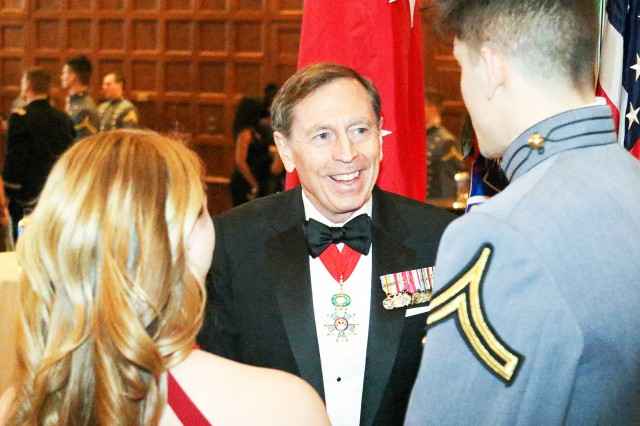 Retired Gen. David Petraeus greets a Class of 2020 cadet and his date in the receiving line prior to the 500th Night Banquet in the Cadet Mess Hall Jan. 26. Petraeus was the guest speaker at this year's banquet, which celebrates 500 nights until graduation for second class cadets.
