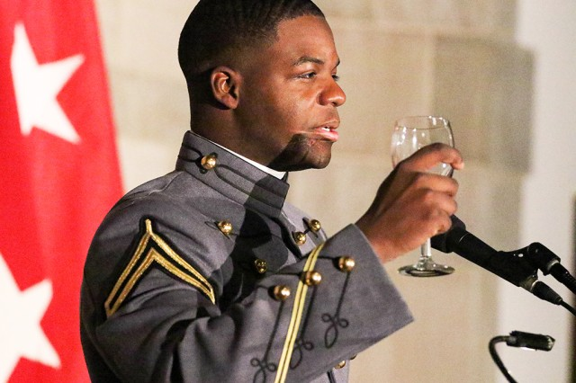 Class of 2020 Cadet President Joshua Phillips does a ceremonial toast to the U.S. Military Academy prior to his opening remarks.