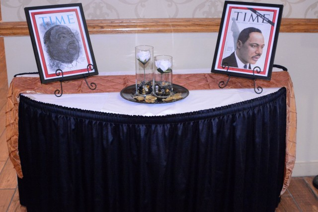 Memorabilia commemorating Dr. Martin Luther King Jr.'s civil rights efforts are displayed during his birthday observance luncheon at the NCO Club Jan. 25.