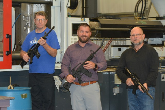 From left: Preston Palmer, Pete Lloyd and Ron Cooper, Training Support Center employees, pose with dummy rifles for training that the site crafts  with the made-in-house injection molds. Fort Jackson is one of just four training rifle-maker locations and the only one that forges its own molds for production.