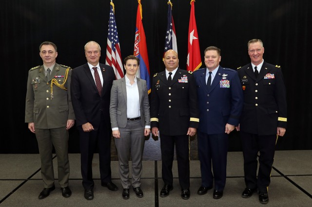 Serbian Prime Minister Ana Brnabic (center left) leads an official delegation during a visit to Ohio, which included meetings with Maj. Gen. John C. Harris Jr. (center right), Ohio adjutant general, Jan. 28, 2019, at the Ohio National Guard Joint Force Headquarters located at the Maj. Gen. Robert S. Beightler Armory in Columbus, Ohio. Also pictured are Col. Dragan Galic (from left), defense, military, naval and air attache with the Serbian Embassy in the U.S.; Serbian Ambassador to the U.S. Djerdj Matkovic; Brig. Gen. James R. Camp, Ohio adjutant general for Air; and Brig. Gen. Steve Stivers, director of the joint staff for the Ohio National Guard.