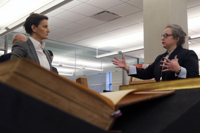 Serbian Prime Minister Ana Brnabic (left) talks Serbian and Serbian-American history with M. A. Johnson of the Hilandar Research Library at The Ohio State University Jan. 28, 2019, at the Hilandar Research Library in Columbus, Ohio. The library holds a photographic record of Serbian cultural heritage alongside manuscripts and documents.