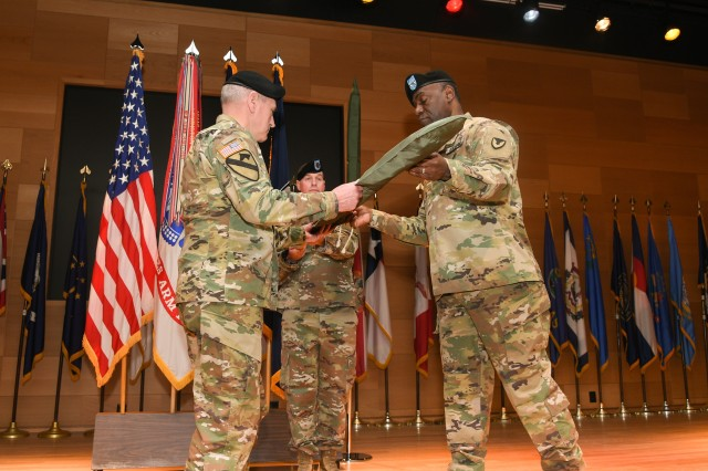 Gen. John M. Murray, commanding general Army Futures Command, and Maj. Gen. Cedric T. Wins, commanding general Combat Capabilities Development Command, uncase the official flag, signifying the transition of the U.S. Army Research, Development and Engineering Command from Army Materiel Command to AFC.