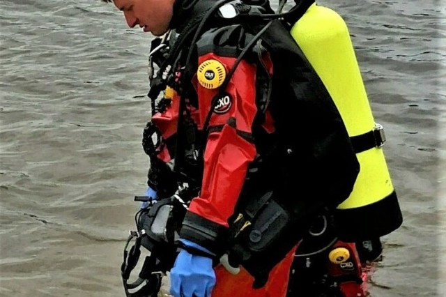 A firefighter with the dive team for the Directorate of Emergency Services Fire Department practices diving May 24, 2016, at Big Sandy Lake on South Post at Fort McCoy, Wis. Fort McCoy has a dive team because of the many lakes and waterways located throughout the installation. (U.S. Army Photo by the Fort McCoy Fire Department.)