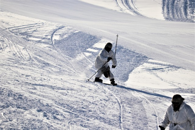 A student in the Fort McCoy Cold-Weather Operations Course (CWOC) Class 19-03 practices skiing Jan. 25, 2019, at Whitetail Ridge Ski Area at Fort McCoy, Wis. In addition to skiing, CWOC students are trained on a variety of cold-weather subjects, including snowshoe training as well as how to use ahkio sleds and other gear. Training also focuses on terrain and weather analysis, risk management, cold-weather clothing, developing winter fighting positions in the field, camouflage and concealment, and numerous other areas that are important to know in order to survive and operate in a cold-weather environment. The training is coordinated through the Directorate of Plans, Training, Mobilization and Security at Fort McCoy. (U.S. Army Photo by Scott T. Sturkol, Public Affairs Office, Fort McCoy, Wis.)