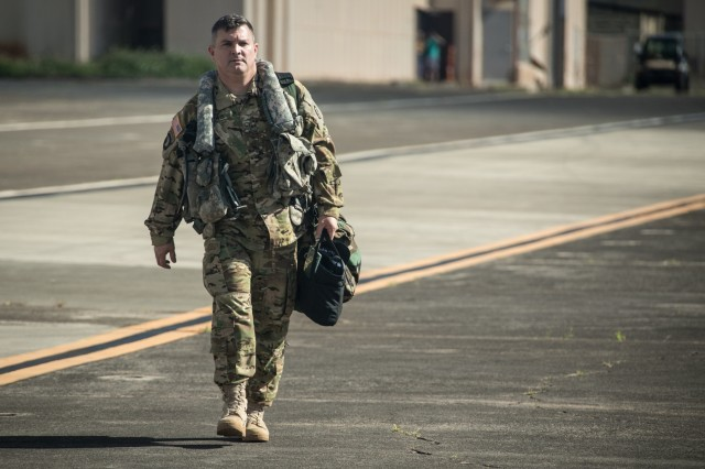 U.S. Army Chief Warrant Officer 5 Myke Lewis, Command Chief Warrant Officer for the 25th Combat Aviation Brigade, 25th Infantry Division, walks on the flight line to an AH-64D Apache Longbow helicopter on Wheeler Army Airfield, Hawaii, Jan. 7, 2019. Chief Lewis has served in the U.S. Army for thirty years and will proceed to his next duty assignment at the Department of the Army Management Office. (U.S. Army photo by 1st Lt. Ryan DeBooy)