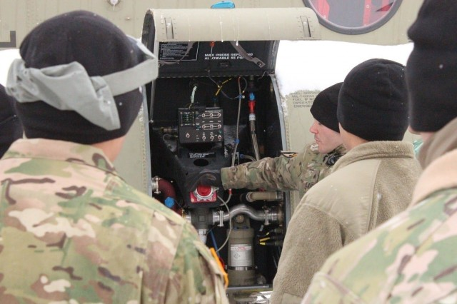 A 12th CAB Soldier explains refuel procedures on the Boeing CH-47F Chinook test in Ansbach, Germany.  The Boeing CH-47F Chinook was one of two aircraft used in the hands-on training, along with the Boeing AH-64D Apache.