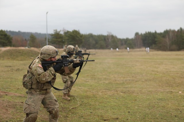"""Soldiers assigned to Palehorse Troop, 4th Squadron, 2d Cavalry Regiment, conduct reflexive firing and stress shooting marksmanship to prepare for the 2019 Gainey Cup in Vilseck, Germany, Jan. 17, 2019. The 2019 Gainey Cup, also known as """"The Best Scout Squad Competition"""", will test the Army's reconnaissance squads' proficiency in reconnaissance and scout doctrine at Fort Benning, Georgia. (U.S. Army photo by Sgt. Timothy Hamlin, 2d Cavalry Regiment)"""