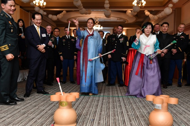 CAMP CASEY, Republic of Korea- Marlene Barretto, wife of 2nd Infantry Division/ROK-U.S. Combined Division Command Sergeant Major Phil K. Barretto, joins Gye, Yeon-suk, wife of Dongducheon Mayor Choi, Yong-deok in a friendly game of Tuho during the division Lunar New Year Reception at the Warrior Club, Jan. 31. Republic of Korea and U.S. service members and their spouses joined together with distinguished guests to celebrate an early Seollal and the enduring ROK-U.S. Alliance.