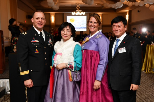CAMP CASEY, Republic of Korea - Maj. Gen. D. Scott McKean, 2nd Infantry Division/ROK-U.S. Combined Division commanding general, and his wife Kim (third from left) join Dongducheon Mayor Choi, Yong-deok and his wife Gye Yeon-suk during the division Lunar New Year Reception at the Warrior Club, Jan. 31. Republic of Korea and U.S. service members and their spouses joined together with distinguished guests to celebrate an early Seollal and the enduring ROK-U.S. Alliance.