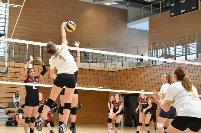 Capt. Kathleen Stewart, jersey number 1, plays volleyball in a tournament with her Wiesbaden Community team.