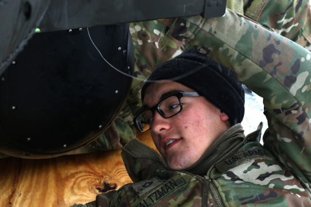 Pfc. Samuel Saltzman, a UH-60 Black Hawk helicopter repairer with B Co., 601st Aviation Support Battalion, 1st Combat Aviation Brigade, 1st Infantry Division reassembles a HH-60M Black Hawk Jan. 30, 2019 at Zeebrugge, Belgium. The 1st Combat Aviation Brigade's deployment marks the fourth rotation of a U.S. aviation brigade presence in Europe supporting Atlantic Resolve. (U.S. Army photo by Cpl. Gabrielle Weaver)