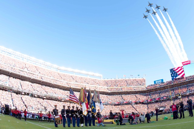 Members of a joint service color guard present the national colors during the singing of the national anthem for Super Bowl 50 on Feb. 7, 2016, in Santa Clara, Calif. This year's Super Bowl will showcase a color guard with Soldiers assigned to the Army Military District of Washington as well as Soldiers stationed in South Korea.