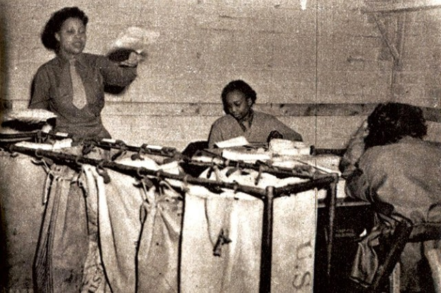Members of the 6888th sorting mail.
