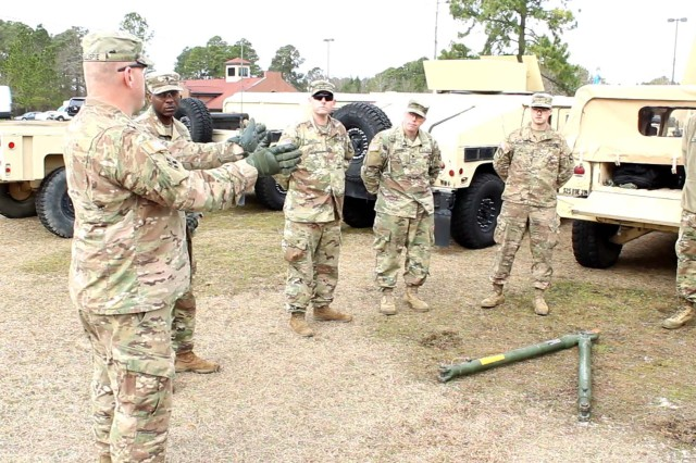FORT BRAGG, N.C. -- Staff Sgt. Jonathan Gillispie instructs Soldiers on the tow bar during Headquarters and Headquarters Detachment 319th Military Intelligence Battalion, 525th Military Intelligence Brigade's Tent Exercise on January 23, 2019 at Fort Bragg, N.C. (U.S. Army photo by Sgt. Jeremiah Meaney, 525th MI BDE PAO/Released)