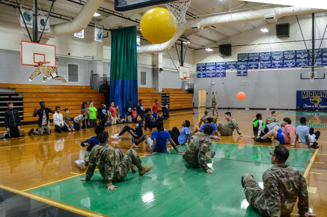COLUMBUS, Ga. (Feb. 1, 2019) -- Soldiers from Charlie Company, 1st Battalion, 46th Infantry Regiment, at Fort Benning, Georgia, play a game of cage ball with students from Midland Middle School in Columbus, Georgia, Feb. 1. The Soldiers participated in the gym class as a part of Fort Benning's Partners in Education program, which promotes continued partnerships between the military units and schools within seven school districts of Columbus, Phenix City, Alabama, and the surrounding community. (Photo by Megan Garcia, Fort Benning Maneuver Center of Excellence Public Affairs)