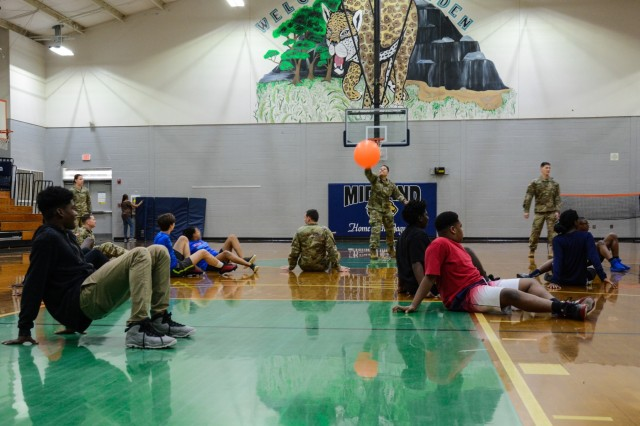COLUMBUS, Ga. (Feb. 1, 2019) -- Soldiers from Charlie Company, 1st Battalion, 46th Infantry Regiment, at Fort Benning, Georgia, play a game of cage ball with students from Midland Middle School in Columbus, Georgia, Feb. 1. The Soldiers participated in the gym class as a part of Fort Benning's Partners in Education program, which promotes continued partnerships between the military units and schools within seven school districts of Columbus, Phenix City, Alabama, and the surrounding communities. (Photo by Megan Garcia Maneuver Center of Excellence, Fort Benning Public Affairs)