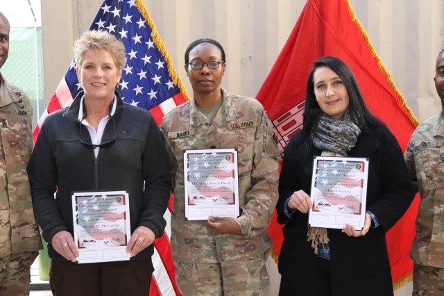 Three members of the Kabul City Gates Phase 1 Project, Sheila McCarthy, Lt. Col. Jacqueline Baird, and Oksana Strekha receive A-team awards from Afghanistan leadership, Command Sergeant Major, Nathaniel Atkinson and Commanding Officer, Jason E. Kelly. Other members of the team will be awarded at a later date.