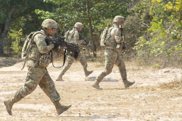 Soldiers with 5th Battalion, 20th Infantry Regiment, run toward their objective during squad training Jan. 29, 2019, at Klong Kluea, Thailand. Exercise Hanuman Guardian is  designed to build readiness and collaboration through bilateral military engagements with the U.S. and Royal Thai Army.
