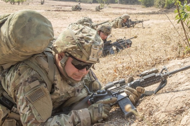 Soldiers with 5th Battalion, 20th Infantry Regiment, prepare to attack an enemy target during squad training Jan. 29, 2019, at Klong Kluea, Thailand. This was part of Hanuman Guardian, an exercise designed to build expeditionary readiness at multiple echelons by deploying task-organized forces over vast distances where they conduct operations upon arrival.