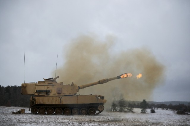 A U.S. Army M109A6 Paladin howitzer, assigned to Bravo Battery, 1st Battalion, 82nd Field Artillery Regiment, 1st Armored Brigade Combat Team, 1st Cavalry Division, fires its main gun at a range during Table Six qualifications at U.S. Army Garrison Bavaria in Grafenwoehr, Germany, Jan. 9, 2019. Ironhorse Soldiers are training in Germany as they close out their rotation across Europe in support of Atlantic Resolve.