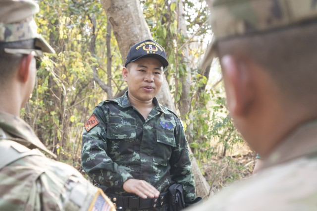 Corporal Yultana Choomma, a Royal Thai Army soldier, instructs U.S. Soldiers with 5th Battalion, 20th Infantry Regiment, on techniques to spot IEDs in a jungle environment during counter-IED training Jan. 30, 2019, at Camp Nimman Kolayut, Thailand. This was part of Hanuman Guardian, an exercise designed to build readiness through tough, realistic training with the U.S. and Royal Thai Army. Soldiers from both nations trained together and shared tactics for better understanding and interoperability between the two armies