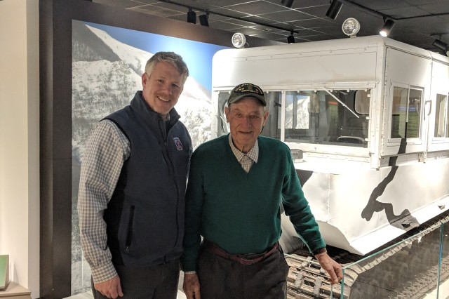 Howard Hall, a 99-year-old World War II veteran, meets with Sepp Scanlin, 10th Mountain Division and Fort Drum Museum director, during his first visit to the installation on Jan. 29. (Photo by Mike Strasser, Fort Drum Garrison Public Affairs)