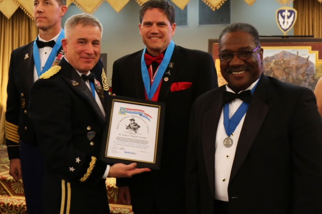 Maj. Gen. Gary Johnston, Commanding General, U.S. Army Intelligence and Security Command and Charles Atkins, president of the Military Intelligence Corps Association, present Wayne Prosser, III Corps geospatial intelligence, with the Knowlton Award, Feb. 1, 2019, Fort Hood, Texas. The Knowlton Award is only presented to those who have made a significant contribution to the military intelligence field. (U.S. Army photo by Sgt. Melissa N. Lessard)