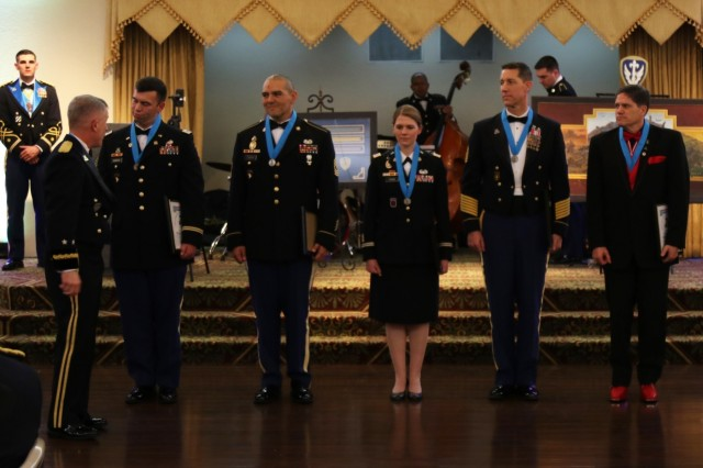 Soldiers and Civilians are awarded the Knowlton Award and the Gold Rose award during the Military Intelligence Ball, Feb. 1, 2019, Fort Hood Texas. The Knowlton awards is awarded to individuals who have made a significant contribution to the military intelligence field. (U.S. Army photo by Sgt. Melissa N. Lessard)