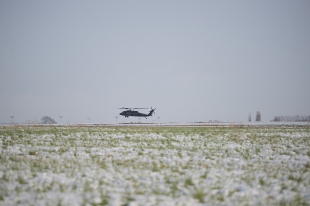 A U.S. Army UH-60 Black Hawk helicopter of the 1st Combat Aviation Brigade, 1st Infantry Division, arrives to Chievres Air Base, Belgium, Jan. 30, 2019.  The brigade will deploy to Germany, Poland, Latvia and Romania for nine months to train with NATO partners in support of Atlantic Resolve.