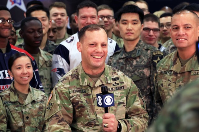 CAMP HUMPHREYS, Republic of Korea -Maj. Gen. D. Scott McKean, San Jose, California native, commanding general, 2nd Infantry Division/ROK-U.S. Combined Division, asks National Football League commentators a question about the San Francisco 49ers, a hometown NFL team during the Super Bowl pre-game interview. McKean and Command Sgt. Maj. Phil K. Barretto, Aiea, Hawaii native, 2ID/RUCD sergeant major, were interviewed during the pre-game show about the unit's unique nature as the only permanently forward-deployed combined division.