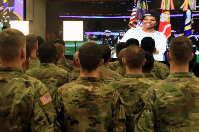 CAMP HUMPHREYS, Republic of Korea - Soldiers throughout the 2nd Infantry Division/ROK-U.S. Combined Division watch Gladys Knight sing the National Anthem during the first-ever Super Bowl live-shot from South Korea, Feb. 4 at Freeman Hall. The CBS Sports, the official channel for the Super Bowl, broadcasted live from Korea as both ROK Army soldiers and U.S. Army Soldiers stood side-by-side.