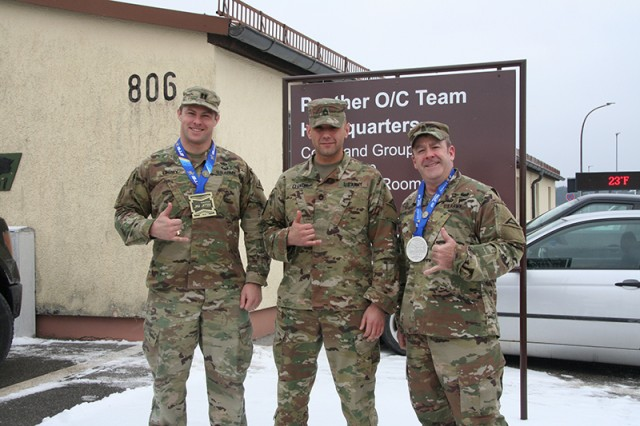 Capt. Jeff Linzey, left, third place, Sgt. 1st Class Kurt Legnon, instructor for the Brazilian Jiu-Jitsu Hohenfels Team, and Command Sgt. Maj. Christopher McMillian, second place, proudly show their medals after participating in the International Brazilian Jiu-Jitsu Federation European Championship 2019 in Portugal, Jan. 14-21.
