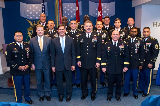 Secretary of the Army Mark T. Esper, Under Secretary of the Army Ryan McCarthy, Army Vice Chief of Staff James McConville and Maj. Gen. Frank Muth recognize the Army's top recruiters for the first quarter of fiscal year 2019 during an awards ceremony at the Hall of Heroes, Pentagon, Washington D.C., Feb. 4, 2019.