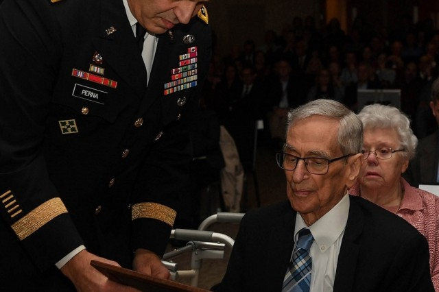 Gen. Gustav Perna, the commander of the Army Materiel Command, John Shipley, the long-time director of the Aviation Integration Directorate, an award during Shipley's retirement ceremony and induction into the AMC Hall of Fame. (photo by Sr. Airman Derek Seifert)