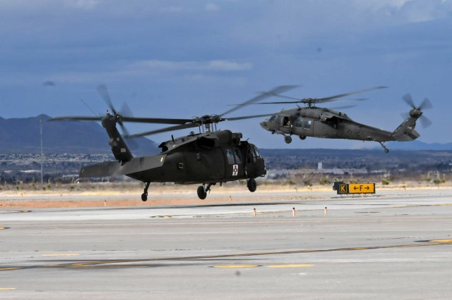 Two National Guard UH-60A/L Black Hawk helicopters ascend from Biggs Army Airfield in route to a medical evaluation exercise, Fort Bliss, Texas, Feb. 1, 2019. National Guard Black Hawk aviation regiments from Wy., Miss., N.J., and N.Y have been taking part in pre-mobilization training exercises alongside their CH-47F Chinook counterparts from Neb. and Colo. for three weeks, trained and evaluated by Soldiers of 1st Armored Division, Combat Aviation Brigade and First Army Division West.