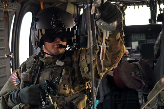 Sgt. Daniel Schoenwolf, a critical care flight paramedic with 2nd General Support Aviation Battalion, 211th Aviation Regiment, Wy. Army National Guard, maintains his grip on an intravenous saline solution bag during a UH-60 A/L Black Hawk helicopter medical evacuation exercise, Fort Bliss, Texas, Jan. 30, 2019.
