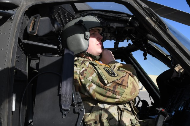 Chief Warrant Officer 2 Preston Blocker, an air medical evacuation pilot with Gulf Company, 1st General Support Aviation Battalion, 168th Aviation Regiment, Miss. Army National Guard, makes adjustments on his flight helmet prior to a UH-60 A/L Black Hawk helicopter medical evacuation exercise, Fort Bliss, Texas, Jan. 30, 2019.