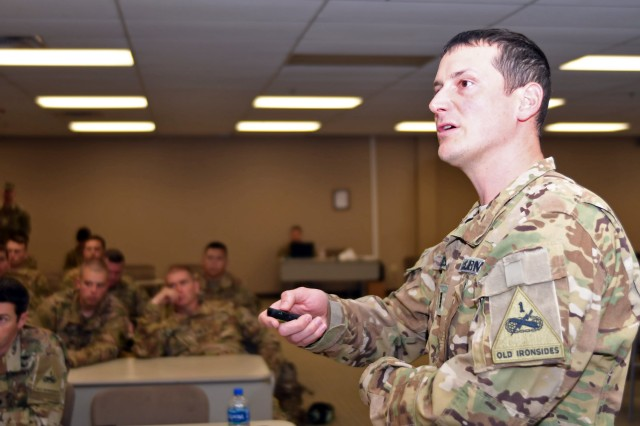 Chief Warrant Officer 4 Michael Maides, training officer for 2nd Battalion, 135th Aviation Regiment, Neb. Army National Guard, gives a mission brief prior to a CH-47F Chinook helicopter night infiltration and exfiltration exercise, Fort Bliss, Texas, Jan. 31, 2019.