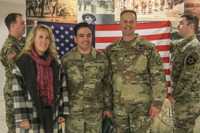 Reenlistment unites two generations of Army