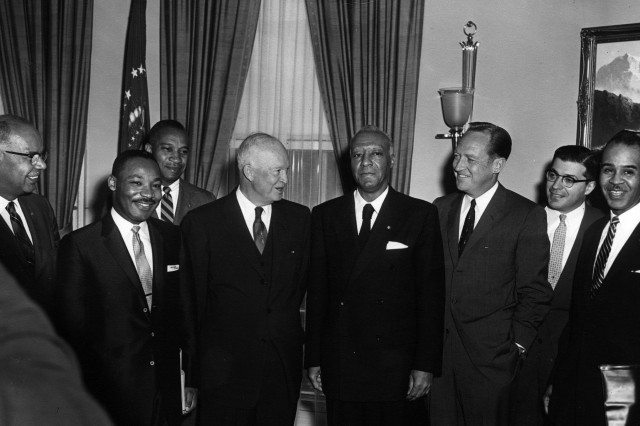 Civil rights leaders (from left): Lester Granger, Dr. Martin Luther King, Jr., E. Frederic Morrow, A. Philip Randolph, William Rogers, Rocco Siciliano, and Roy Wilkins stand with President Eisenhower (center).