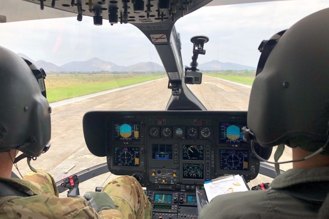 "Chief Warrant Officer 5 Jay Enders, Charlie Co. 1st Battalion, 112th Aviation conducts a test flight in an LH-72 ""Lakota"" with his Thai counterpart on January 17, at the Royal Thai Army Aviation base in Lop Buri, Thailand."
