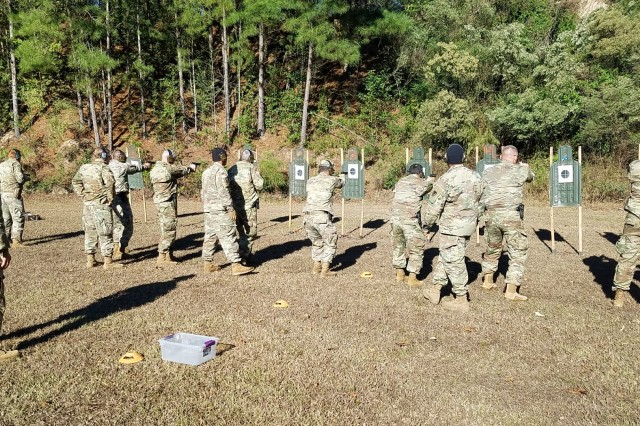 Security Assistance Training Management Organization instructors coach Security Assistance Team Training and Orientation Course students on proper firing technique during 9mm pistol block of instruction.