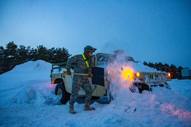 A Soldier from 10th Mountain Division digs his vehicle out of snow on Jan. 29, 2019 on Fort Drum, NY.