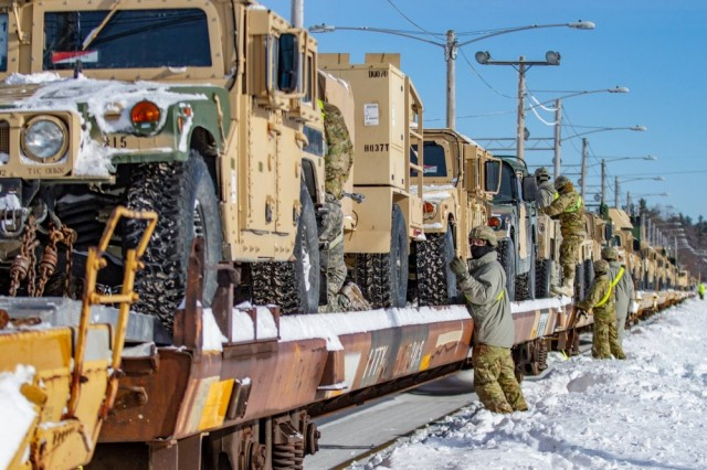 Soldiers from 1st Brigade Combat Team, 10th Mountain Division load vehicles to rail cars during rail-load operations Jan. 26, 2019 on Fort Drum, New York.