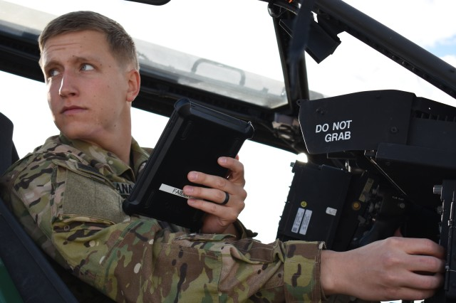 1st Lt. William Viana utilizes the Electronic Flight Bag while performing preflight checks, Feb. 1, at Fort Bliss, Texas. EFBs allow for the immediacy of information, which is a significant advantage when it comes to content distribution during flight operations.